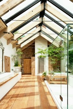 Amazing bathroom! Vaulted glass ceiling, glass shower