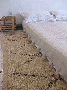 A Moroccan pom pom blanket. I'll take the Beni ouarain rug too... http://www.etsy.com/shop/bringyourownsunshine