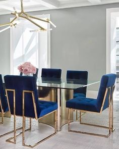 Okay I am OBSESSED with these blue velvet chairs with gold legs. They would make any dinning room pop! #dinningroominspiration : Pinterest