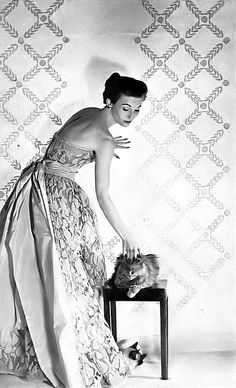1951 Mary Jane Russell in Balenciaga's beautiful leafy gray lace with a sash in exquisite shade of pink taffeta