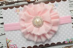 Shabby chic light pink flower headband with large pearl embellishment- newborn, infant, child, teen or adult sizes. $12.50, via Etsy.