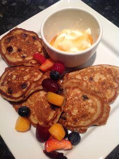 Blueberry pancakes, Greek style yoghurt, honey and fresh fruit.