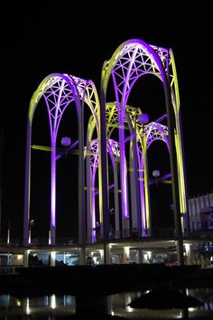 The purple and gold lighting on the Seattle Science Center is, in honor of the University of Washington Huskies.