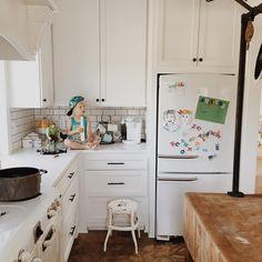 White kitchen, white appliances, GE Artistry refrigerator, butcher block island
