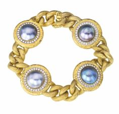 14kt and 18kt yellow gold ladies bracelet featuring 4 11.5mm Blue Mabe Pearls which are surrounded by round brilliant Diamonds. The textured curb link chain with a hand hammered finish has a hidden tongue clasp with a safety.  This is a Jorge Adeler custom design.