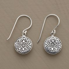 """A fleur-de-lys motif carved in a sea of swirls adorns the fronts and backs of our exclusive sterling silver earrings. The decorative disks hang from sterling French wires. Exclusive. Approx. 7/8""""L."""