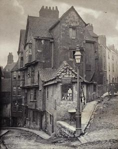 "John Hill Morgan, OP08887.    The junction of Steep Street and Trenchard Street, Bristol, 1866.   This platinum print is a lovely object in its own right, with the subtle tones of the photographic process adding to the air of picturesque dilapidation. However I particularly like the small nugget of grittier Victorian reality buried in the image. The shop window in the centre of the picture contains a sign reading ""hair bought"": presumably one of the options for the poor of Bristol in hard…"