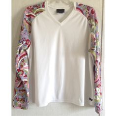 Athleta Floral Jersey Top Good condition. A few light yellow stains on the front. The back has a long snag. Nice Athleta top. Like a cycling jersey or other athletic garment. Textured white fabric body. Colorful floral/geometric pattern sleeves. V neck front. Rubber Athleta logo on one side of the front. Size 1X. Measurements: Armpit to armpit 24 inches across. Waist 23 inches across. Length 25 inches. +All offers welcome Athleta Tops Tees - Long Sleeve