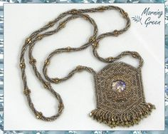Bronze Amulet Bag with Glass Amethyst Cabochon, Bronze and Silver Matte Delica Seed Bead Amulet Bag(193) by Morningreen on Etsy https://www.etsy.com/listing/208313168/bronze-amulet-bag-with-glass-amethyst