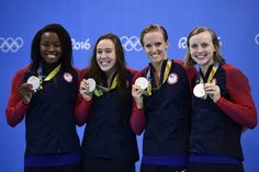 Team USA (L-R) Simone Manuel, Abbey Weitzeil, Dana Vollmer and Katie Ledecky pose with their silver medals after the Olympics Women's 4 x 100m Freestyle Rela...