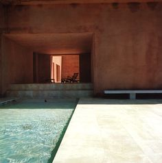 warm travertine basin in mallorca spain. by marco de valdivia.