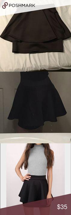 Tobi black high waist peplum skirt Stunning black skirt! Brand new with tags. Bought it for my formal but ended up wearing something else! Make an offer!  Tobi Skirts Mini