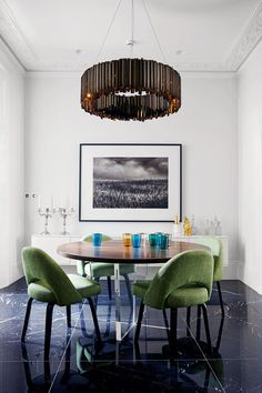 A round table and modern lighting in this white dining room in a Victorian terrace in London, interiors by Sarah Stewart-Smith - dining room ideas for furniture, decoration and design.