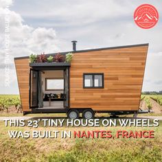 """Intrepide"" Tiny House on Wheels Built in France! This tiny house on wheels was built in Nantes, France, featuring an indoor/outdoor living flow, a living room with a desk Small Tiny House, Tiny House Living, Tiny House Plans, Tiny House On Wheels, Home Living Room, Tiny House Trailer, Tiny House Movement, Built In Couch, Tyni House"