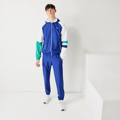 Lacoste Sport | Preview | LACOSTE Sports Tracksuits, Lacoste Sport, Sports Footwear, Top Luxury Brands, Track Suit Men, Drawstring Pants, Sport Outfits, Normcore, Shorts