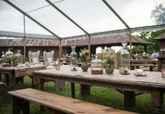 Benches instead of chairs? Different centerpieces: vases, containers, candles and unusual flowers (artichokes, ferns, succulents)