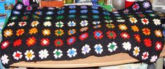 Crochet black background. I am thinking big huge flowers on a black background for my bed.