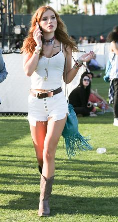 Bella was looking more than just all-white, nailing festival fashion for the second day in a row in a white strappy tee and shorts combo, teamed with errrmazing cowboy boots and loads of awesome accessories.   - Sugarscape.com