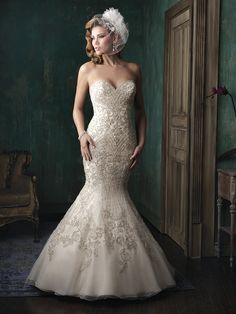 STYLE: C348  Beaded to perfection, this curve-hugging gown is sure to stun.  Colors: White/Silver, Ivory/Silver, Gold/Ivory/Silver Fabric: Embroidered Organza Size: 2 - 32