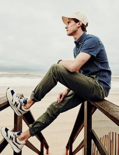 J.Crew men's short-sleeve shirt in indigo striped Irish linen, stretch chino in 484 fit, Ebbets Field Flannels® for J.Crew solid ball cap and New Balance® for J.Crew 997 Moonshot sneakers.