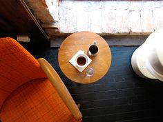A black coffee taken to one of the three chairs at Tim Wendelboe, a coffee shop and small-batch roaster in Oslo.