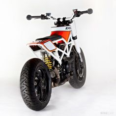 Ducati Multistrada by Ad Hoc - Fat bars, bar ends, imagination, and 1000cc of skinny bike
