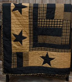 """The Delaware line is a blend of patchwork and stars with colors of black and tan. This is 100% cotton fabric, quilted throw and measures 50"""" x 60"""". With cuttin"""