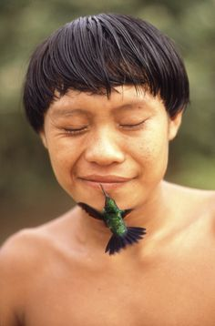 With hummingbird. Yanomamis Indians, Roraima, Brazil. - Explore the World with Travel Nerd Nici, one Country at a Time. http://TravelNerdNici.com