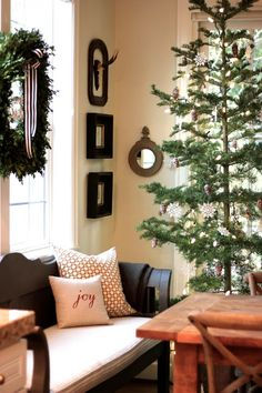 Perfect tree ~ this is how I like a Christmas tree to be! It is open and airy and skinny and just right.  Found at: forever*cottage