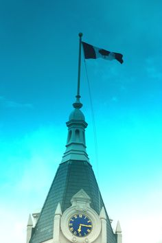 City Hall Flag, Stratford, Ontario, Canada.  Taken by my daughter through the top part my front windshield. A budding photographer, unedited.