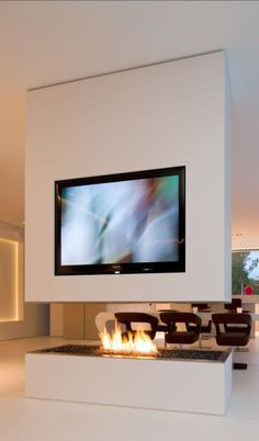 Karl Dreer and Bembé Dellinger Architects// no more choosing between tv and fireplace// Contemporary interior design Home Fireplace, Modern Fireplace, Fireplace Design, Fireplace Ideas, Fireplaces, Bedroom Fireplace, Home Interior Design, Interior Architecture, Living Spaces