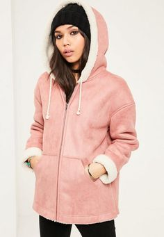 Stay away from cold and look fierce af in this pink faux shearling hooded jacket. With pockets and zip fastening - you're all set for the cold season.