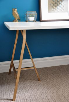 DIY trestle desk with gold legs (parts from IKEA) http://www.shelterness.com/diy-glamour-trestle-desk/