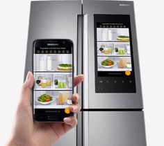Hands holding a Smart Phone and Family Hub Product image with door closed. Foods inside is displayed on both mobile and family hub screen. Best Fridge Freezer, Samsung Fridge Freezer, Tiny Fridge, Clean Fridge, Smart Home Security, Home Security Systems, College Fridge, Fridge Decor, Best Smart Home