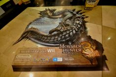 This 3D floor graphic was designed and installed across retail stores in Australia for Nintendo to promote its Monster Hunter Tri game for gamers.