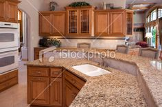 Custom Luxury Eat-In Kitchen With Granite Counters, Oak Cabinets; Kitchen update with oak cabinets and white appliances.