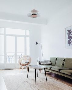 A Parisian apartment with vintage details and olive green sofa #HowtheFrenchLive