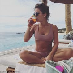 Hot mama: Jessie James Decker, 28, shows off her trim figure in a lilac bikini in Los Cabo...