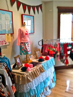 """love this table skirt for the gift shop! and a flag banner that says """"lewistown hoppers"""" Boutique Decor, Children's Boutique, Boutique Stores, Boutique Displays, Boutique Ideas, Display Ideas, Booth Ideas, Consignment Shops, Store Displays"""