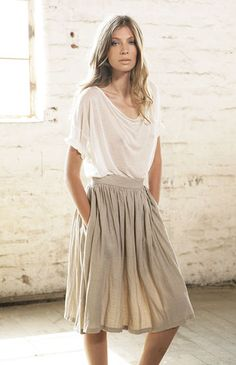 Love the skirt, love the shirt, love them together! I'd throw on a camel belt and heels to complete the outfit- and probably a tank top under