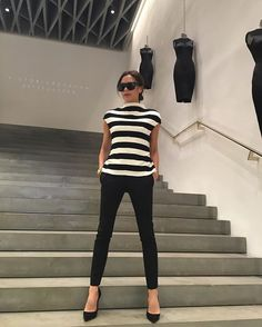 Pin for Later: With Just 1 Photo, Victoria Beckham Proves Why This Outfit Will Always Be a Classic Victoria Posed on the Steps Wearing an Outfit Combination of a Striped Shirt and Black Pants