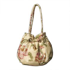My grommet purse in butter yellow floral. I call this design Romance. From the VireoCollection.