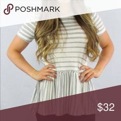 Grey striped ruffle bottom top Grey and white striped ruffle bottom top is made of 96% Rayon and 4% Spandex. Such a fun casual top! Tops Blouses
