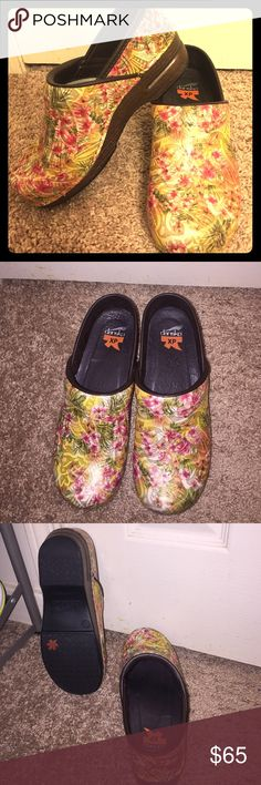 Dansko XP clogs size 37 (6.5/7). Beautiful floral clogs with yellow, pink, and green. Worn only once! No visible scuffs or issues. Excellent condition. Rated among the top shoes for comfort in the medical profession Dansko Shoes Mules & Clogs