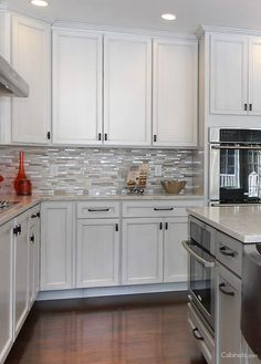 White and gray cabinets are perfect if you want a subtle two-toned kitchen.