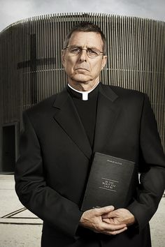 Priest holding Charles Saatchi's Be The Worst You Can Be (it's funny if you've read the book)