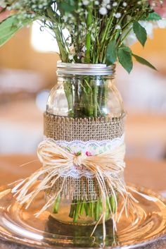 #burlap, #mason-jars  Photography: Rachwal Photography - rachwalphotography.com  Read More: http://www.stylemepretty.com/canada-weddings/manitoba/winnipeg/2014/01/21/diy-vintage-wedding-in-winnipeg-manitoba-canada/