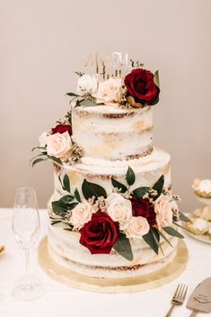 2 tier cake with the color scheme: green, white, burgundy