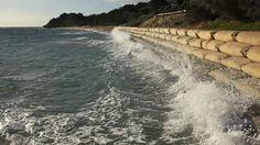 Rising tide: waves crash into sandbags where Victoria's Portsea Beach used to be.