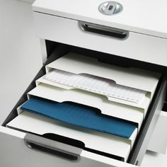 KVISSLE has a place for everything!  The wall magazine rack fits perfectly in the GALANT drawer unit.